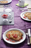 Laid table with rustic potato pancakes Royalty Free Stock Images