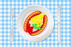 Laid table with sausage, french fries and ketchup Royalty Free Stock Images