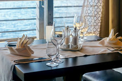 Laid table by the sea stock image
