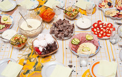 Laid table with snacks Stock Photos