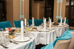 Laid table with tableware and dishes, ready for banquet Stock Photo