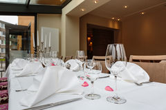 Laid tables reserved for diners Royalty Free Stock Images