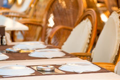 Laid tables in a summer cafe Royalty Free Stock Image