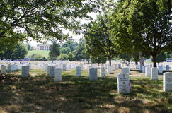 Laid at Their Doorstep. Washington, DC, 6 July 2012 - A view of the Custis-Lee Mansion with the gravestones of Arlington National Cemetery in the foreground Royalty Free Stock Image