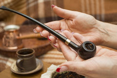 Laid tobacco smoking pipe Royalty Free Stock Images