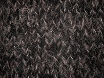 Laine tricotée, fil de laine noir Image stock