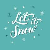 Laissez lui neiger lettrage de Noël écrit par main avec des flocons de neige Photographie stock libre de droits