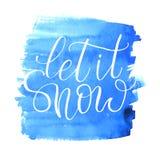 Laissez lui neiger texte tiré par la main calligraphique sur la texture d'aquarelle Photographie stock