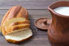 Lait et pain Photographie stock