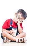 Lait mignon de boissons de garçon Photos libres de droits