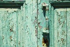 laiton r de canarias de l'Espagne dans un abrégé sur en bois fermé vert porte Image libre de droits