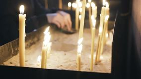 The laity in the Christian Church puts candles. Close up. Religious institution. Faith in God stock video