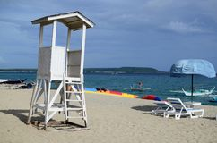 empty white lifeguard tower with cloudy sky in white sand beach royalty free stock images