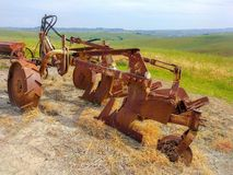 Lajatico - Pisa - 25 May 2019 - Old plow machine in a field of Tuscany stock photo