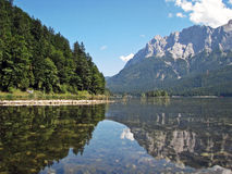 Lake. Mountain mountains lake water tree trees wood germany swiss austria europe munich landscape stone cliff bavaria mirage forest Stock Image
