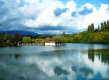 Lake. Rural house on a little lake, Italy Stock Image