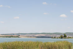 Lake. Surrounded by vegetation located in the Spanish town of Arcos de la Frontera, fields are the background, on a sunnyday Stock Images