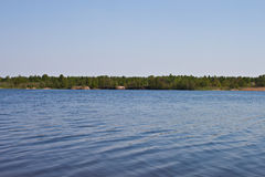 Lake. Blue sky and green trees in nature over lake with reflections Royalty Free Stock Photo