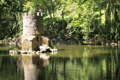 Lake. Small tower in the middle of a lake in the Pena Park Sintra - Portugal Royalty Free Stock Photos