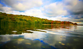 The Lake. A view of a lake in Derbyshire England with strong colours Stock Photography