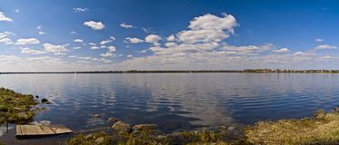 Lake. Panoramic show of the sky reflected on rural lake royalty free stock photography