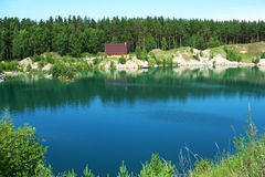 Lake. The house ashore at dark blue lake Stock Photos