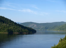 Lake. Surrounded with hills grown with wood Royalty Free Stock Image