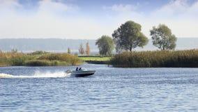 Lake. Swimming on a motorboat on lake Kish, near to Riga, Latvia Royalty Free Stock Photography
