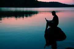 On the lake. Man with laptop Royalty Free Stock Photos