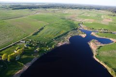 Lake from above. Aerial view of a land and a lake Stock Images