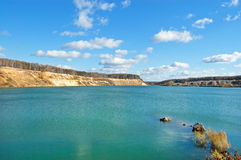 Lake with abrupt sandy coast. And aquamarin water stock photos