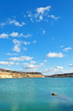 Lake with abrupt sandy coast. And aquamarin water stock images