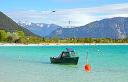 Lake achensee with fishing boat and kite surfers Stock Images