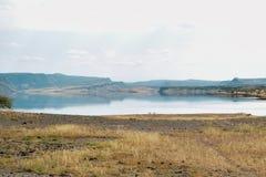 Lake against an arid landscape. Lake Magadi against an arid landscape, Magadi, Rift Valley, Kenya  safari travel scenic beautiful nature natural dry desert royalty free stock photography