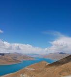 Lake against blue sky Royalty Free Stock Image