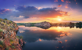 Lake against colorful sky with clouds at sunset Royalty Free Stock Photography