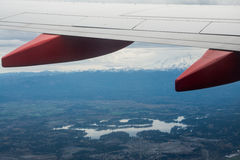 Lake Through an Airplane Wing. This was a picture I took when I was leaving Washington from the airplane window. I loved the bottom of the wing and the fact that Royalty Free Stock Photography