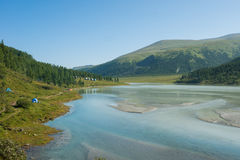 At the lake Akkem. Trekking in the Altai Mountains Royalty Free Stock Photo