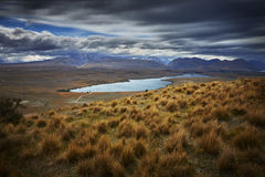 Lake Alexandrina New Zealand. Lake Alexandrina South Island New Zealand with approaching storm Stock Image