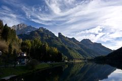 Lake Alleghe in Belluno, under the great Monte Civetta. Journey through the beauties of the city of Belluno in Italy, the pearl of the Dolomites Stock Images