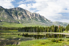 Lake along Chief Joseph Scenic Byway. Reflections in a lake along Chief Joseph Scenic Byway in Wyoming Stock Images