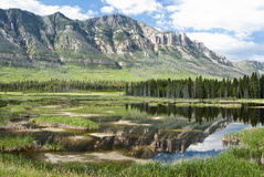 Lake along Chief Joseph Scenic Byway. Reflections in a lake along Chief Joseph Scenic Byway in Wyoming Stock Photography