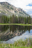 Lake along Chief Joseph Scenic Byway. Reflections in a lake along Chief Joseph Scenic Byway in Wyoming Stock Photos