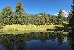Odle reflected in the lake, Italy Stock Photography