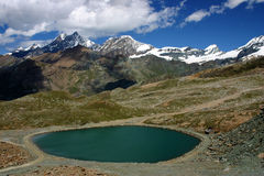 Lake in the alps. High altitude scenery with lake in the alps Stock Photo
