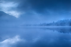 Lake in Alps during misty morning Royalty Free Stock Images