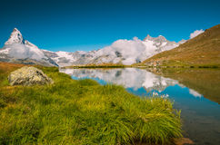 Lake in Alps near to Mattehorn. Lake at mountains in Alps with Matterhorn Royalty Free Stock Photos