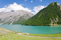 Lake in Alps. The peaks of the Italian Alps in Livigno Stock Photos