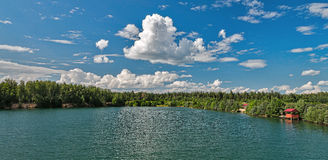 Lake amidst beautiful clouds. Stock Photo