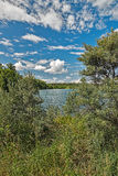 Lake amidst beautiful clouds. Royalty Free Stock Photography